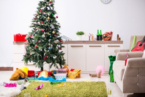 presents under a christmas tree in a messy home